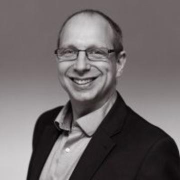 Headshot of Darian Stibbe