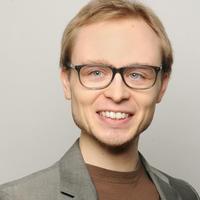Headshot of Odin Muehlenbein
